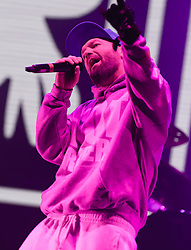 © Licensed to London News Pictures. 28/08/2015. Reading Festival, UK.  Limp Bizkit performing at Reading Festival 2015 28 August 2015 Day 1. In this picture - Fed Durst.   Photo credit: Richard Isaac/LNP