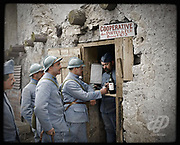 """Colorized photographs soldiers from the World War One<br /> <br /> With his impressive colorized photographs of the World War One, Frédéric Duriez gives us a new look at the conflict that ravaged the world between 1914 and 1918, revealing the difficult daily life of the French soldiers. <br /> <br /> Photo Shows:""""The sentence """"""""cooperative des Portes de Fer"""""""" means cooperative canteen of the Iron Gates, this is a reference of the 161th Infantry Regiment surname : """"""""Régiment des Portes de Fer"""""""". This regiment surname was given during the last phase of the Battle of the Somme in October-November 1916. It was the name of a German trench, called iron gates trench, a very strong German position, in the sector of Rancourt and Sailly-Saillisel, captured by the men of the French 161th Infantry Regiment .<br /> The sentence """"""""cooperative des Portes de Fer"""""""" means cooperative canteen of the Iron Gates, this is a reference of the 161th Infantry Regiment surname : """"""""Régiment des Portes de Fer"""""""". This regiment surname was given during the last phase of the Battle of the Somme in October-November 1916. It was the name of a German trench, called iron gates trench, a very strong German position, in the sector of Rancourt and Sailly-Saillisel, captured by the men of the French 161th Infantry Regiment .<br /> ©Frédéric Duriez/Exclusivepix Media"""