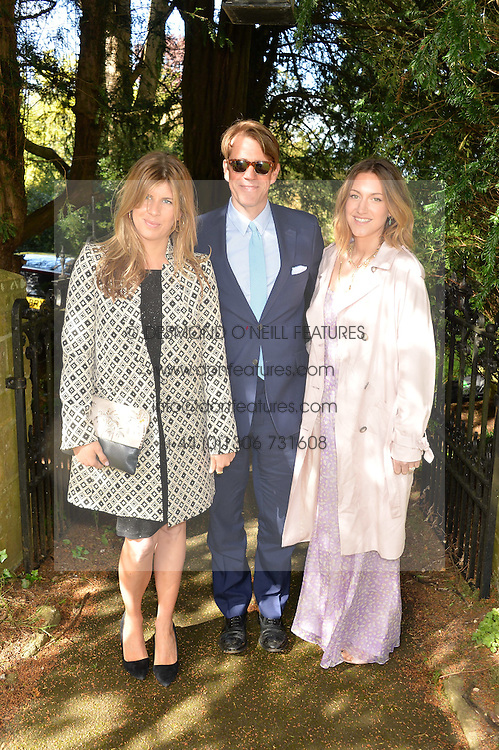 Left to right, KATIE ELLIOT, BEN ELLIOT and his wife MARY CLARE ELLIOT at the wedding of Princess Florence von Preussen second daughter of Prince Nicholas von Preussen to the Hon.James Tollemache youngest son of the 5th Lord Tollemache held at the Church of St.Michael & All Angels, East Coker, Somerset on 10th May 2014.