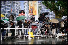 Fans wait in the Rain in Cannes