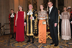 © Licensed to London News Pictures. 14/12/2016. (L to R) British Prime Minister Theresa May, Alderman Dr Andrew Parmley, Lady Mayoress Wendy Parmley and Philip May attend the annual Lord Mayor's Banquet at Guildhall. London, UK. Photo credit: Ray Tang/LNP