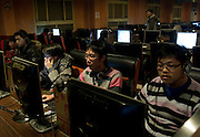 People surf the internet in a cyber-cafe in Shanghai, China.