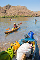 Kayakers head towards the shore after a paddle trip in The Black Canyon, Nevada.