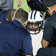ORLANDO, FL - OCTOBER 09:  Jordan Johnson #6 of the Brigham Young Cougars sits up after being injured on the field at Bright House Networks Stadium on October 9, 2014 in Orlando, Florida. (Photo by Alex Menendez/Getty Images) *** Local Caption *** Jordan Johnson