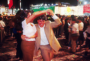 MEXICO CITY, DF, MEXICO: A couple dances on the Zocalo in Mexico City during Mexican Independence Day celebrations, Sept 16.  PHOTO © JACK KURTZ  family  culture  women patriotism
