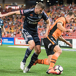 BRISBANE, AUSTRALIA - OCTOBER 7: Luke DeVere of the Roar and Mitchell Austin of the Victory compete for the ball during the round 1 Hyundai A-League match between the Brisbane Roar and Melbourne Victory at Suncorp Stadium on October 7, 2016 in Brisbane, Australia. (Photo by Patrick Kearney/Brisbane Roar)