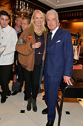 NICKY HASLAM and ANNEKA RICE at a party to celebrate the publication of 'A Designer's Life' by Nicky Haslam held at Ralph Lauren, 1 New Bond Street, London on 19th November 2014.