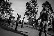 Children play football in the communal square  of the Copa do Povo (People's Cup) camp, Itauquera, São Paulo.The Copa do Povo Camp, is just a few miles from the Arena Corinthians and has 5,000 homeless workers and their families occupied area of fifteen acres. They are homeless after rents skyrocketed because of the World Cup. (Eduardo Leal).