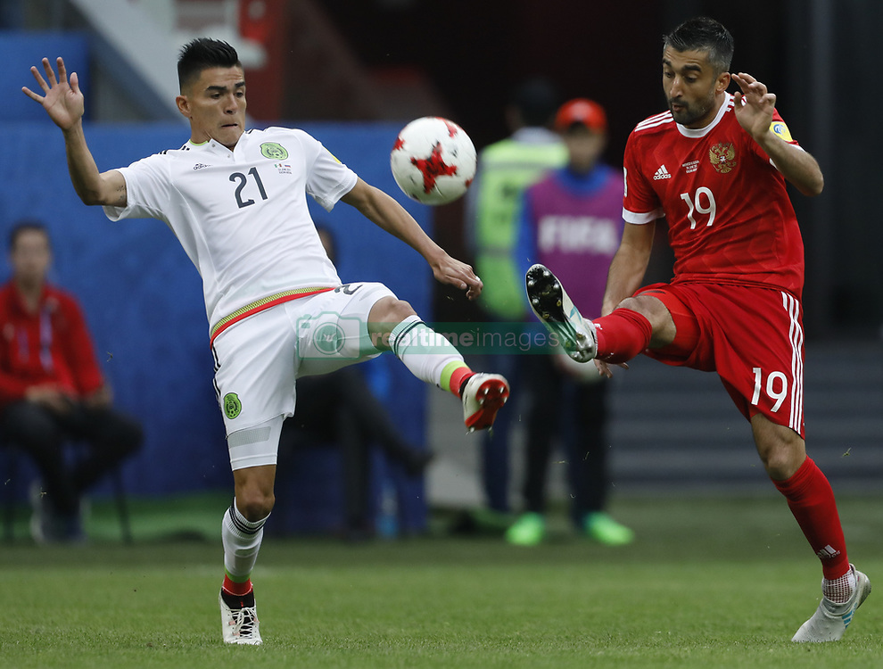 June 24, 2017 - Kazan, Russia - Alexander Samedov (R) of Russia national team and Luis Reyes of Mexico national team vie for the ball during the Group A - FIFA Confederations Cup Russia 2017 match between Russia and Mexico at Kazan Arena on June 24, 2017 in Kazan, Russia. (Credit Image: © Mike Kireev/NurPhoto via ZUMA Press)