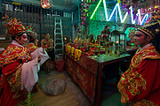 A small Chinese Opera troupe perform at a shrine in the Yaowarat district of Bangkok