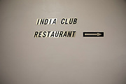 Sign for the famous India Club Restaurant in central London, England, United Kingdom. The India Club at the Strand in London opened its doors in 1946. It was the meeting place of the India League, a British organisation which fought for Indian independence. Its founding members include Lady Mountbatten and Nehru. The club exists within an eight-storey Edwardian building on the Strand and is situated on the upper floors. There is a bar and a restaurant which serves Indian food. Portraits and photos of famous figures from the Indian independence movement adorn the walls. It has retained its original features from the 1940s.