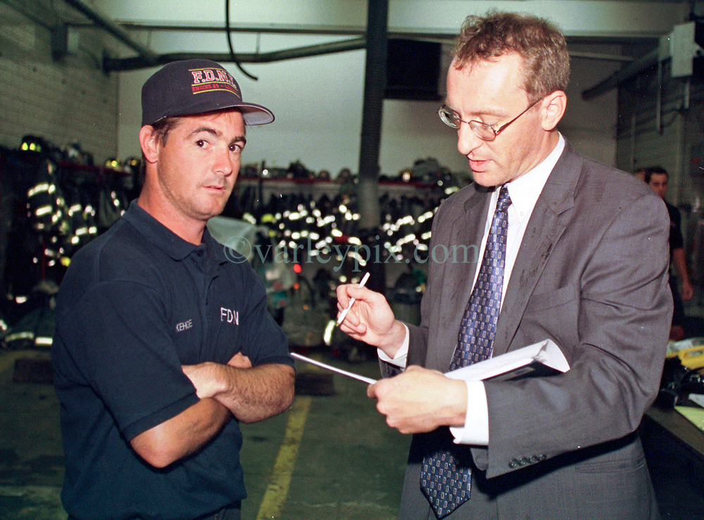 14 September 2001. New York, New York - USA.<br /> Post 9/11 World Trade Center attack.<br /> Mike Kehoe, Hero firefighter of Engine 28, Ladder 11 is interviewed exclusively by Andy Lines of London's Daily Mirror at Kehoe's firehouse on East 2nd Street in the East village early in the morning of Sept 14th. <br /> Mike's image had been published the day before on front pages around the world. It is the iconic image of him ascending the stairs of the World Trade Center as he helped to evacuate people from the terrorist attacks of 9/11. It was assumed Mike had perished when the buildings collapsed. However Mike had miraculously managed to escape the buildings moments before they collapsed. 6 members of his crew were not so fortunate. Mike became a symbol of heroism to many following the vicious Al Queda attacks which claimed over 2,000 victims at the WTC site. This images was published exclusively on the Front Page of the Daily Mirror on 15th Sept, 2001.<br /> Photo exclusive©; Charlie Varley/varleypix.com