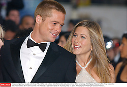 Hollywood glamour couple actor Brad Pitt and his wife actress Jennifer Aniston pictured arriving at the screening of Wolfgang Petersen's film 'Troy' presented out of competition at the 57th Cannes Film Festival in Cannes-France on Thursday, May 13, 2004. Photo by Hahn-Nebinger-Gorassini/ABACA.  | 60044_04