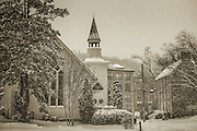 The historic Oella Church in snow. A black and white photograph.