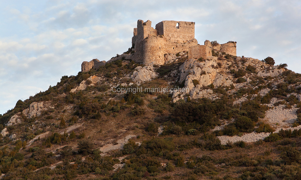 """Aguilar Castle, Chateau d'Aguilar, Cathar Castle, Tuchan, Corbieres, Aude, France. The castle consists of an inner keep built in the 12th century, surrounded by an outer pentagonal fortification from the 13th century with semi-circular guard towers, and is one of the """"Five Sons of Carcassonne"""" or """"cinq fils de Carcassonne"""". It is a listed monument historique. Picture by Manuel Cohen"""
