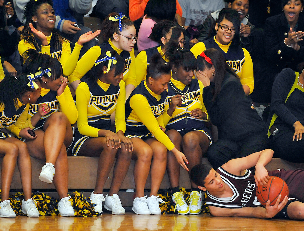 Putnam's cheerleading squad reacts after Amherst Regional's Basil Stewart falls on the court in front of them during play in the first half of the high school basketball game in Springfield, Tues. Feb. 23, 2010. (Photo: Jessica Hill)
