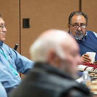 U.S. Rep. Raúl Grijalva listens as Johnny Begay, a former uranium miner discusses how working in the mines has impacted his life at a Navajo Uranium Miners Forum hosted by Grijalva Wednesday, Oct. 2 in Window Rock.