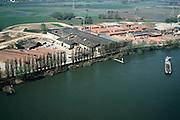 Nederland, Gelderland, Angeren, 04-04-2002; steenfabriek aan de Neder-Rijn (Pannerdensch Kanaal), uit de kleiputten rond de fabriek wordt  klei gebaggerd om in de ovens van de fabriek tot  baksteen en dakpannen gebakken te worden; rechts, op de rivier, duwbak; nijverheid, industrie dakbedekking bouw. Steenfabriek.<br /> luchtfoto (toeslag), aerial photo (additional fee)<br /> photo/foto Siebe Swart