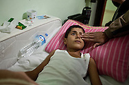 12 year old Saleh from Idlib province in northern Syria, lays paralysed from the waist down in Dar Istishfah care centre. Schrapnel entered his spine when the Syrian airforce bombed his neighbourhood. Reyhanli, Turkey. Bradley Secker for the Washington Post 7/12/2012
