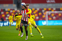 Football - 2020 / 2021 Sky Bet (EFL) Championship - Brentford vs. Wycombe Wanderers  - Brentford Community Stadium<br /> <br /> Tariqe Fosu (Brentford  FC) and Josh Knight (Wycombe Wanderers) compete for the ball<br /> <br /> COLORSPORT/DANIEL BEARHAM