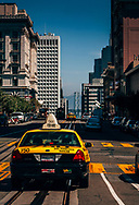 Taxicabs on tram tracks at California Street, in San Francisco, California. ©CiroCoelho.com. All Rights Reserved.