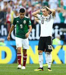 Germany's Mesut Ozil (right) appears dejected after the final whistle