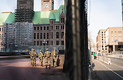 Members of the Minnesota National Guard patrol around the Hennepin County Government Center, the site of the trial of former Minneapolis Police officer Derek Chauvin in Minneapolis, Minnesota, on Tuesday, March 9, 2021.