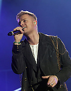 """Westlife Farewell Tour 2012 at the SECC.27-05-12...Nicky Byrne of Irish Super Group Westlife perform during their sell out show at the SECC in the Scottish Leg of their Farewell World Tour. ..Westlife are an Irish boy band formed in 1998. They are to disband in 2012 after their farewell tour. The group's line-up was Shane Filan, Mark Feehily, Kian Egan, and Nicky Byrne. Brian McFadden was part of the group until 2004. Westlife have sold over 45 million records worldwide which includes studio albums, singles, video release, and compilation albums.. Despite the group's worldwide success, they only have one hit single in the United States, """"Swear It Again"""", which peaked in 2000 on the Billboard Hot 100 at number 20. The band were originally signed by Simon Cowell and are managed by Louis Walsh. The group have accumulated 14 number-one singles in the United Kingdom, the third-highest in UK history, tying with Cliff Richard..The group had also broken a few records, including """"Music artist with most consecutive number 1's in the UK"""", which consists of their first seven singles and only behind The Beatles and Elvis Presley..The band have 14 UK number ones and 25 top ten singles, consisting of 20.2 million records and videos in the UK across their 14-year career - 6.8 million singles, 11.9 million albums and 1.5 million videos. The Band are best known for amazing songs such as Flying Without Wings and Safe....At The SECC, Glasgow..Picture  Mark Davison/ ProLens PhotoAgency/ PLPA.Sunday 27th May 2012."""