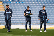 Wycombe Wanderers players inspect the pitch during the EFL Sky Bet League 1 match between Oxford United and Wycombe Wanderers at the Kassam Stadium, Oxford, England on 30 March 2019.