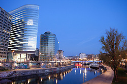 Danube canal modern office building Vienna night