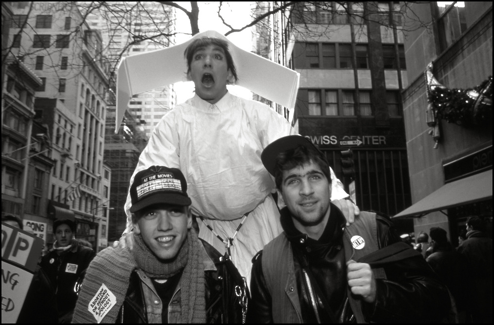 David Evans, Matt Ebert and Ryan Landry of ACT UP and WHAM! made history, on December 8,1989, with a massive protest at St.Patrick's Cathedral. Five thousand people protested the Roman Catholic Archdiocese's public stand against AIDS education and condom distribution, and its opposition to a women's right to abortion.