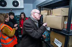 Pictured: Kevin Stewart inspects the sell-by date of produce in the cold store as Lynne Corrie, Depot manager explains how things operate to Elene Whitham and Aileen Campbell<br /> <br /> Today, Communities Secretary Aileen Campbell was joined by Councillor Elena Whitham, Cosla Community Wellbeing Spokesperson, Kevin Stewart, Minister for Local Government, Housing and Planning and Jon Sparkes Chief Executive of Crisis as she visited Cyrenians' Good Food depot where she met staff at the depot and toured the facility which redistributes surplus food to not-for-profit organisations. <br /> <br /> Ger Harley | EEm 27 November 2018