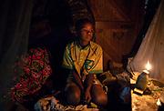 Samuel Onyango, 12, in his home in the slum of Korgocho, close to the Dandora rubbish dumpsite in the capital Nairobi, Kenya.
