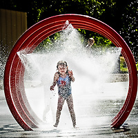 Ariena Rossum, 5, of Chico, CA, enjoys the pelting spray of a water ring at Salmon Creek Park Thursday, July 24, 2008. Ariena and her family were visiting her aunt, Jenny Wolfe, of Vancouver, for her baby shower. <br /> (The Columbian/ N. Scott Trimble)