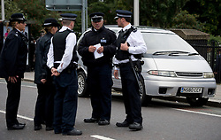 © London News Pictures. 19/09/2013. London, UK. Police stand un front of a car used as a replica for the car Mark Duggan was travelling in on the day of his death during visit by a jury to the scene where Mark Duggan was shot dead by armed police in an incident that sparked the 2011 London Riots. The visit is part of an ongoing inquest into the death of Mark Duggan. Photo credit: Ben Cawthra/LNP