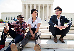April 27, 2017 - Washington, District of Columbia, U.S - Youth plaintiffs, from left,  ISAAC VERGUN, AJI PIPER, and KIRAN OOMMEN sit on the steps of the Supreme Court in Washington, D.C., after a a press conference. The youth are part of 21 plaintiffs represented by Our Children's Trust in a landmark federal lawsuit which accuses the federal government of violating their constitutional rights. (Credit Image: © Robin Loznak via ZUMA Wire)