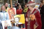 Her Majesty the queen and members of the royal family celebrate Saturday 29 April 2006 Queensday in the province flevoland in the cities  Zeewolde and almere.<br /> <br /> Hare Majesteit de Koningin en leden van de Koninklijke Familie vieren zaterdag 29 april 2006 Koninginnedag mee in de provincie Flevoland en wel in Zeewolde en Almere.<br /> <br /> On the Photo / Op dce foto: Queen Beatrix talks with of of the student that made the portrait paints of CKV (centre artistic shaping) in almere / Koningin Beatrix praat met een van de studenten  van CKV (Centrum Kunstzinnige Vorming) in Almere.