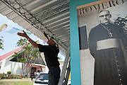 A worker at the Church of the Divine Providence in San Salvador, hangs small, colorful flags as El Salvador prepares for the beatification ceremony and mass announcing the beatification of Archbishop Oscar Romero. The Archbishop was slain at the alter of his Church of the Divine Providence by a right wing gunman in 1980. Oscar Arnulfo Romero y Galdamez became the fourth Archbishop of San Salvador, succeeding Luis Chavez, and spoke out against poverty, social injustice, assassinations and torture. Romero was assassinated while offering Mass on March 24, 1980.