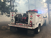 A Larimer County Sheriff's Office type 6 engine arrives to protect structures from the East Troublesome Fire in Rocky Mountain National Park, October 24, 2020. © 2020 William A. Cotton
