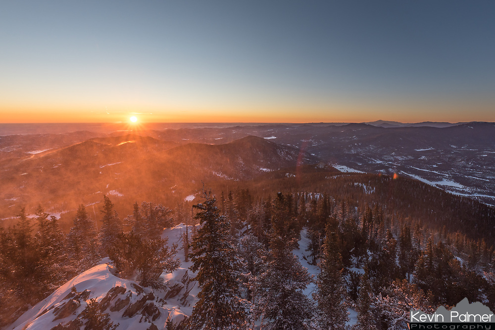 After not being able to see the sun at all the previous day, this morning dawned crystal clear at Squaw Mountain. But it was very windy with lots of blowing snow. At night I measured a wind chill as low as -40°F.