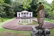 Reflecting pool at the Botanical Garden on Kauai, Hawaii with statue.