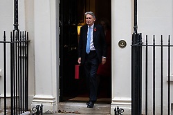 © Licensed to London News Pictures. 29/10/2018. London, UK. Chancellor of the Exchequer Philip Hammond leaves 11 Downing Street as part of a photocall on the autumn budget statement day. Photo credit : Tom Nicholson/LNP