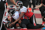 """Under those two Chicago Force players is Taylor Hay from Edwardsville. The  dimunitive Slam RB is 4'10"""" and weighs 140 pounds. She was running the ball when tackled, and kept possession of the ball."""