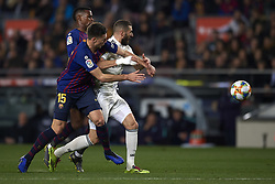 February 6, 2019 - Barcelona, Barcelona, Spain - Karim Benzema of Real Madrid  and Lenglet of Barcelona battle for the ball during the Spanish Cup (King's cup), first leg semi-final match between FC Barcelona and  Real Madrid at Camp Nou stadium on February 6, 2019 in Barcelona, Spain. (Credit Image: © Jose Breton/NurPhoto via ZUMA Press)
