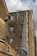 External walls of two prison wings are protected with razor wire, anti-drone netting and metal bars over the cell windows of HMP Pentonville, London, UK.  HM Prison Pentonville is an English Category B men's prison, operated by Her Majesty's Prison Service. Pentonville Prison is located on  Caledonian Road in the Barnsbury area of the London Borough of Islington, north London, United Kingdom. (Photo by Andy Aitchison)