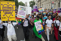 London, UK. 24th July, 2021. Peter Tatchell and Phyll Opoku-Gyimah lead thousands of LGBTI+ protesters on the first-ever Reclaim Pride march. Reclaim Pride replaced the traditional Pride in London march, which many feel has become too commercial and strayed from its roots in protest, and was billed as a People's Pride march for LGBTI+ liberation.