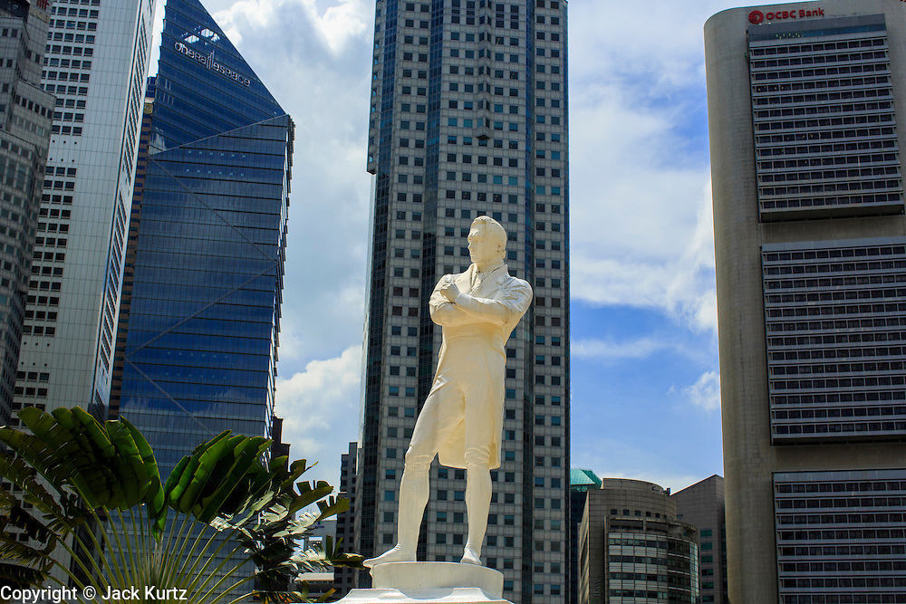21 DECEMBER 2012 - SINGAPORE, SINGAPORE:  International bank and financial services buildings overlook the statue of Sir Stamford Raffles located on the north bank of the Singapore River, where Raffles originally landed in Singapore. The polymarble statue was unveiled in 1972 and was made from plaster casts of the original 1887 figure that currently stands opposite Victoria Concert Hall.The Raffles' Landing Site is the location where tradition holds that Sir Stamford Raffles landed in on 29 January 1819. The site is located at Boat Quay within the Civic District, in the Downtown Core of the Central Area, Singapore's central business district.   PHOTO BY JACK KURTZ