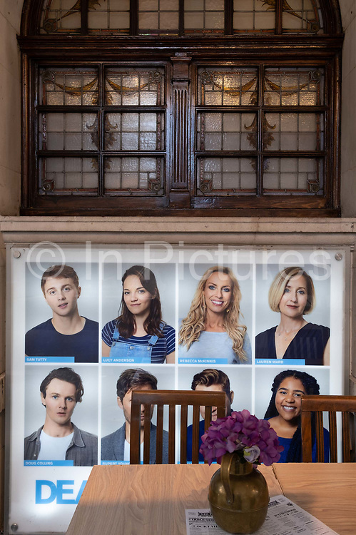 Portraits of cast members for the 'Dear Evan Hansen' musical look on to empty tables outside the Noel Coward Theatre on St. Martin's Lane in the heart of the capital's West End Theatreland, still closed to audiences during the Coronavirus pandemic, on 29th September 2020, in London, Westminster, England. Despite the government's £1.15bn financial rescue package for the Arts industry and cultural organisations in England , made up of £880m in grants and £270m of repayable loans, London's theatre industry has been hit hard by the pandemic, being closed since the March lockdown closures which has affected 137,250 Arts industry jobs, worth £21.2bn in direct turnover.