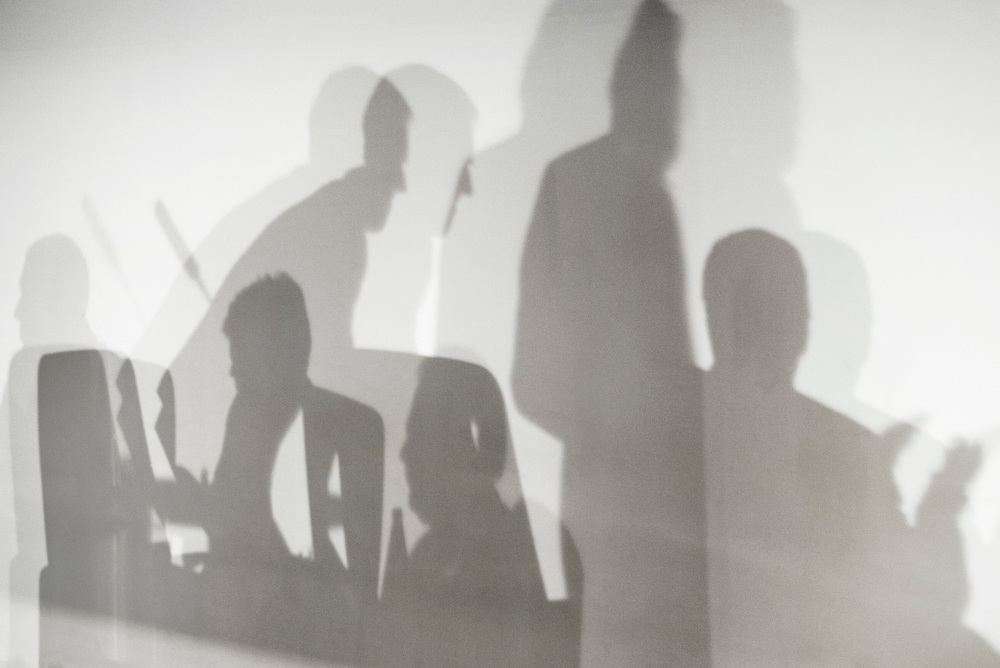 Netherlands. The Hague. Photo: Patrick Post. Shadows on the wall during a board meeting.