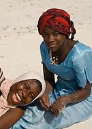 Local women in colourful dress on the beach at Paje, Zanzibar, Tanzania